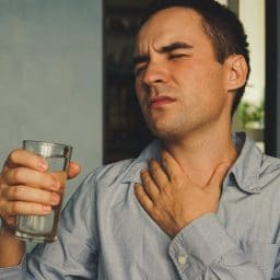 A parched throat and a glass of water in hand