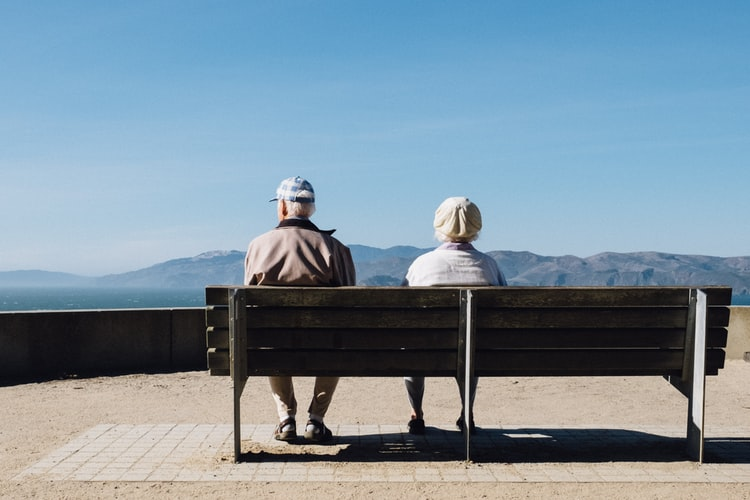 Couple sitting at bench