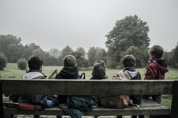 Children sitting outside.