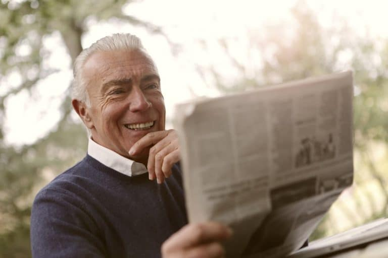 Man reading newspaper.